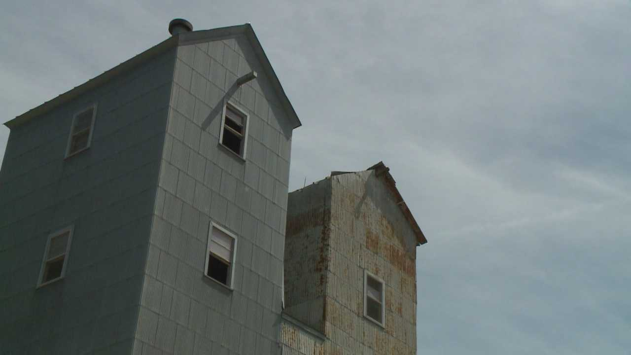 Plans call for two century-old grain elevators in the town of Casey to be torn down.