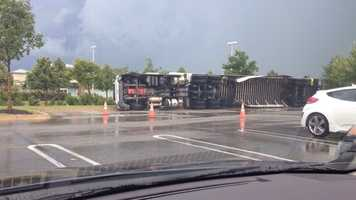 High winds blow semi over at Costco.