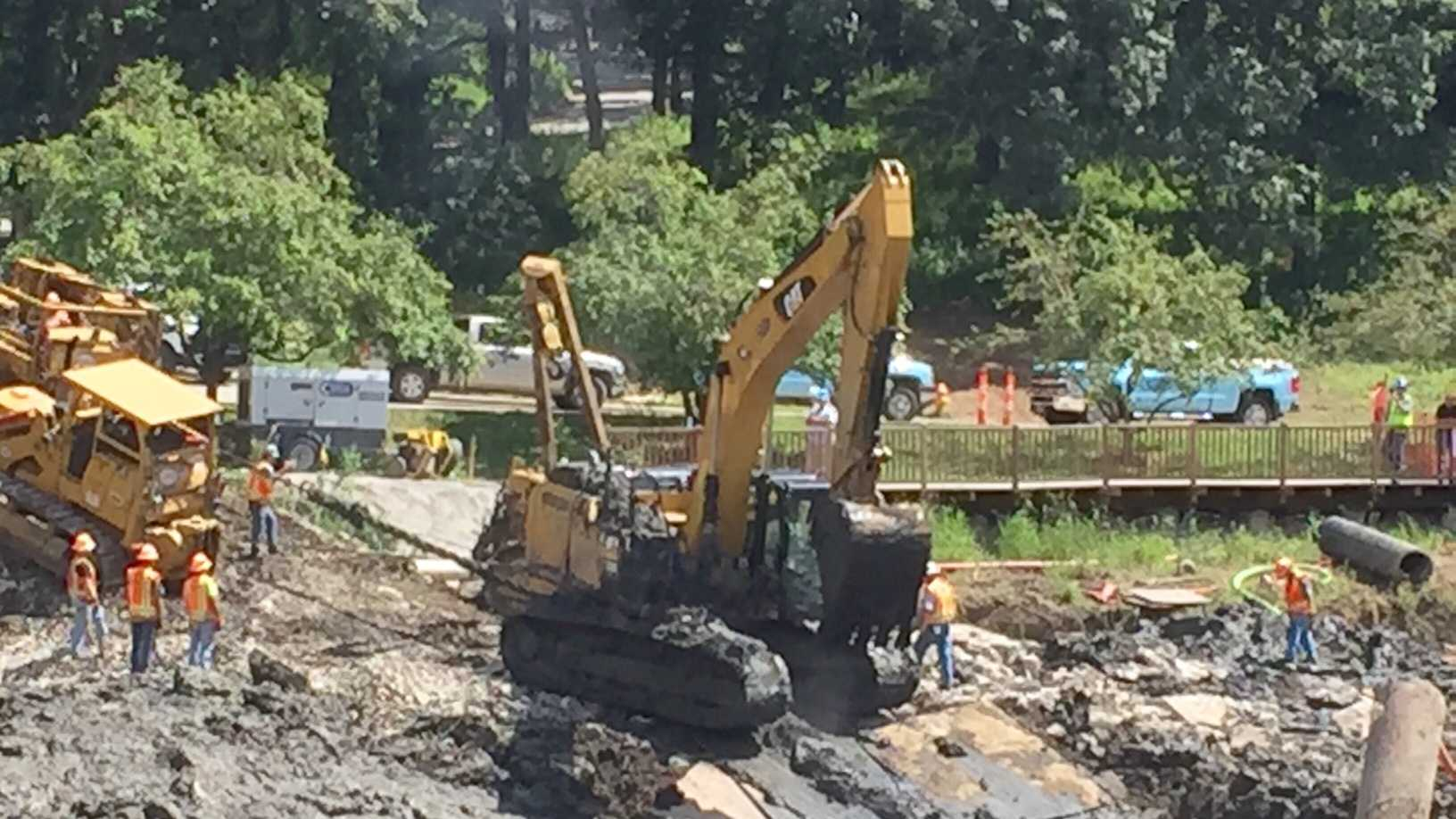 The half-million-dollar excavator was finally freed Monday afternoon after spending three days stuck in the mud.