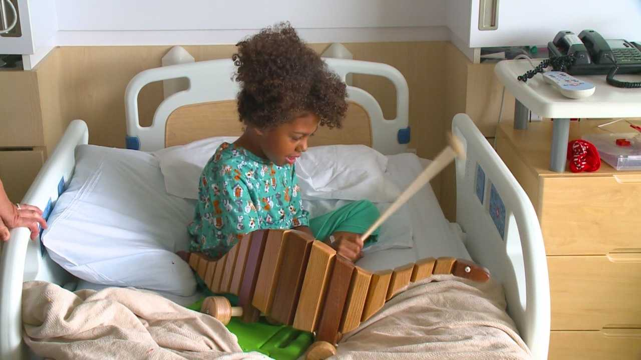 A Lacona man is using a special talent to bring a smile to young faces in hospitals.