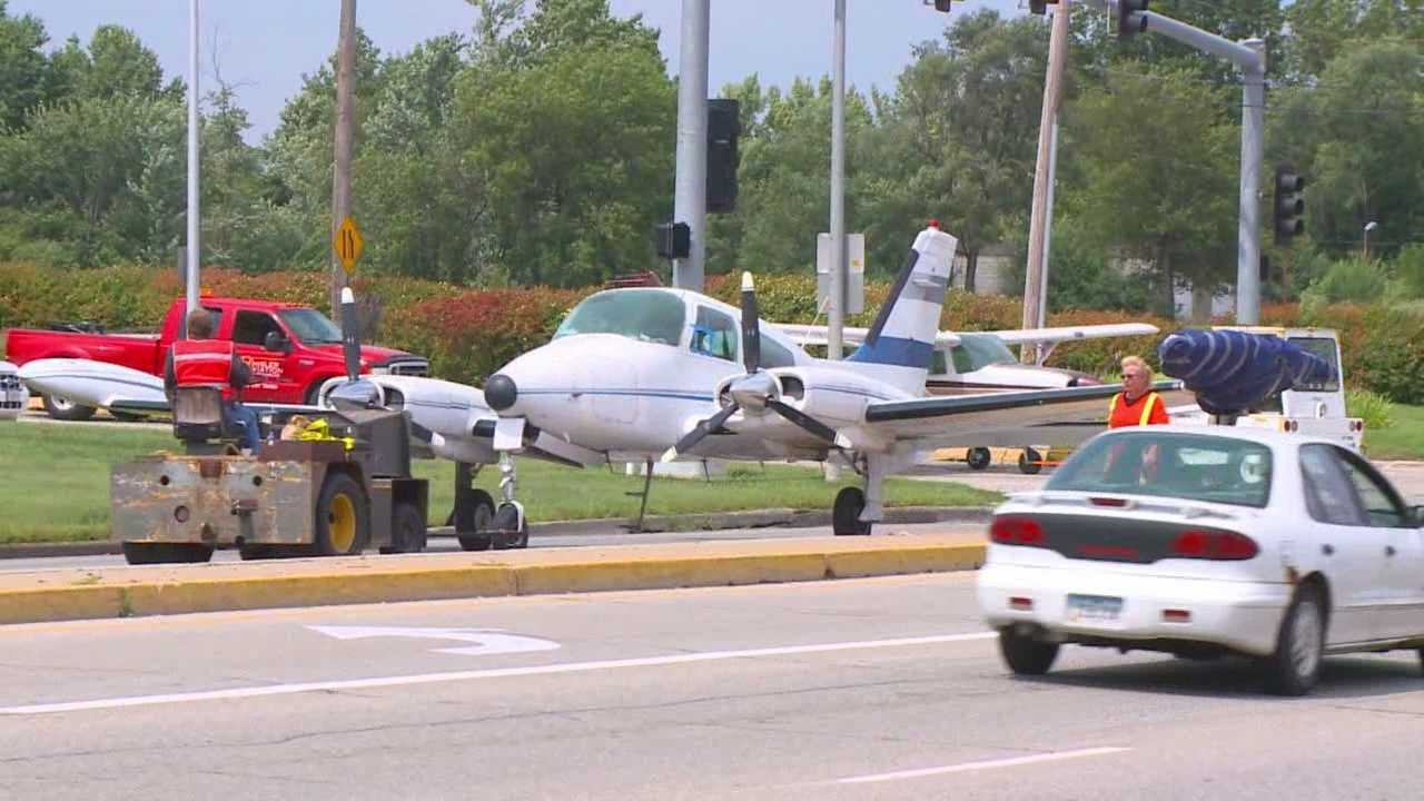 It was quite a sight for anyone who spotted four planes and a helicopter slowly moving down Des Moines streets Saturday.