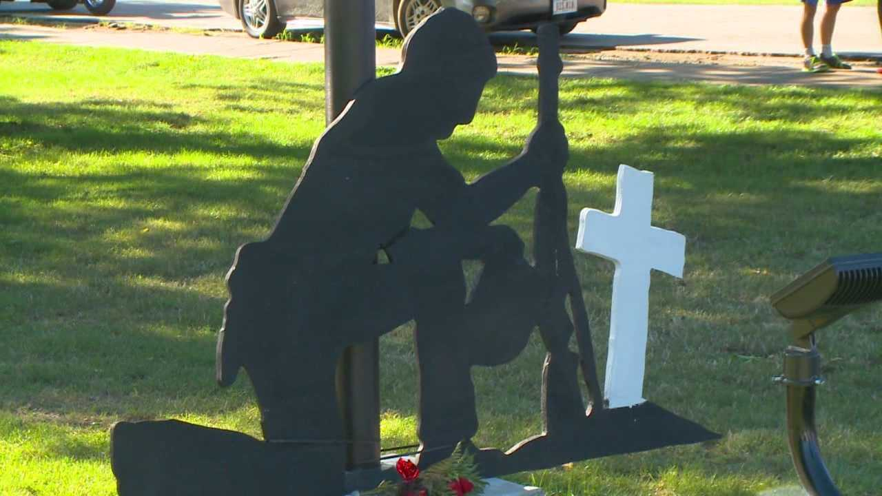 The statue of a kneeling soldier at a cross in a city park is still causing controversy in Knoxville.