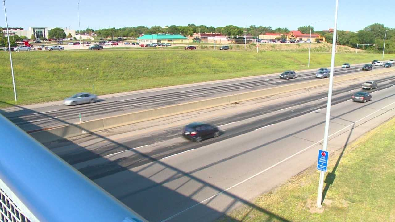 Freeway construction has left long asphalt stains and rough patches along six miles of I-235.
