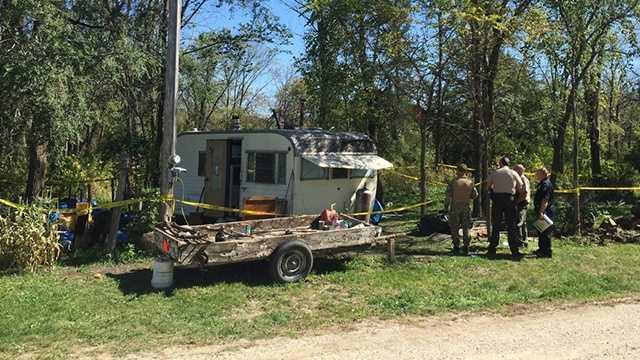 Man found dead inside trailer.