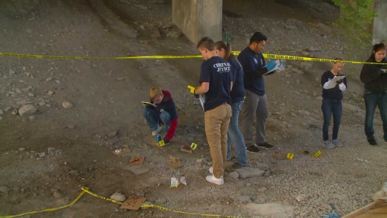 A group of Des Moines teens spent Thursday morning under the Fleur Drive bridge investigating a mock homicide scene.
