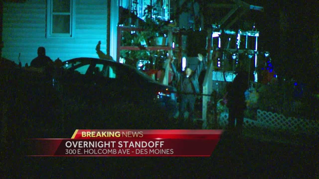 An overnight standoff in Des Moines ended after the suspect surrendered.