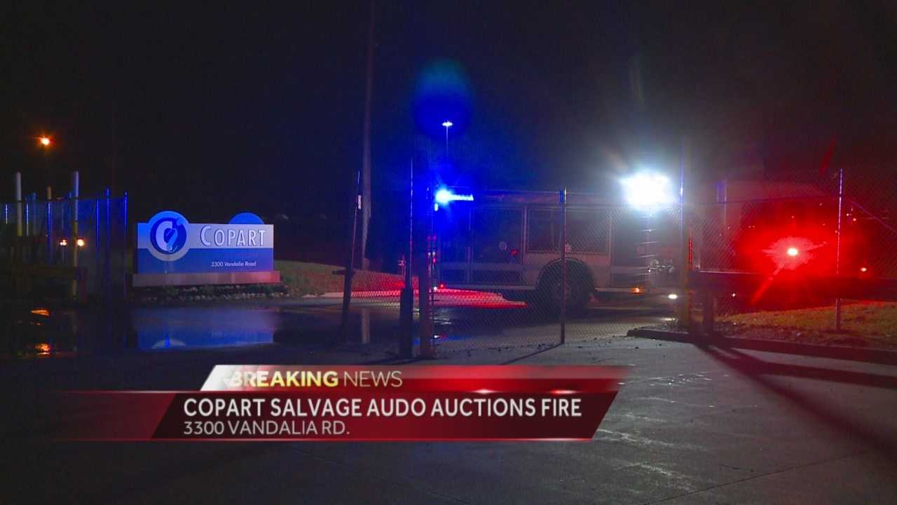 Firefighters battle an early-morning fire at an auto auction.
