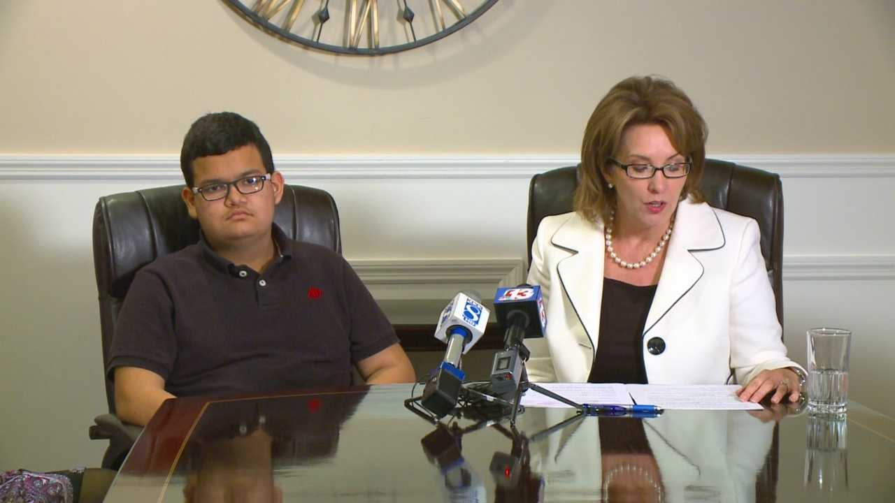 A student and his lawyer addressed reporters Tuesday regarding a school bus assault last week.