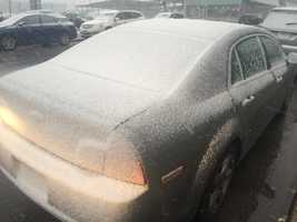Snow coats car in downtown Des Moines at 3:40 p.m.