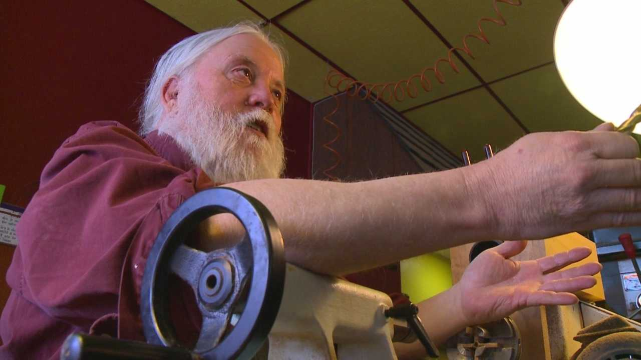 This time of year, anyone with a white beard gets a double take, especially if you're a toymaker who's set up shop in the middle of downtown.