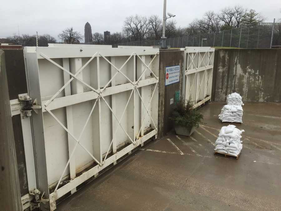 Water Works closing flood gates at main water processing plant near downtown Des Moines, preparing for flooding.