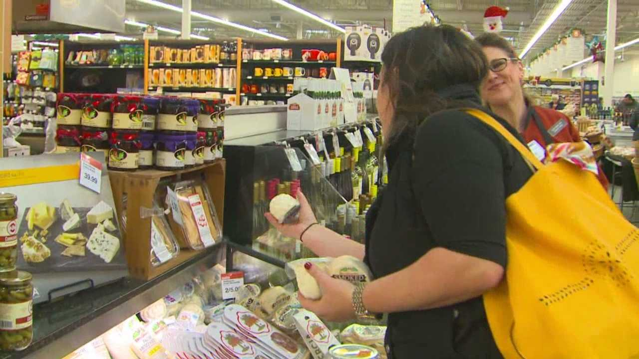 Grocery stores were mobbed Thursday as 11th-hour shoppers picked up last-minute ingredients.