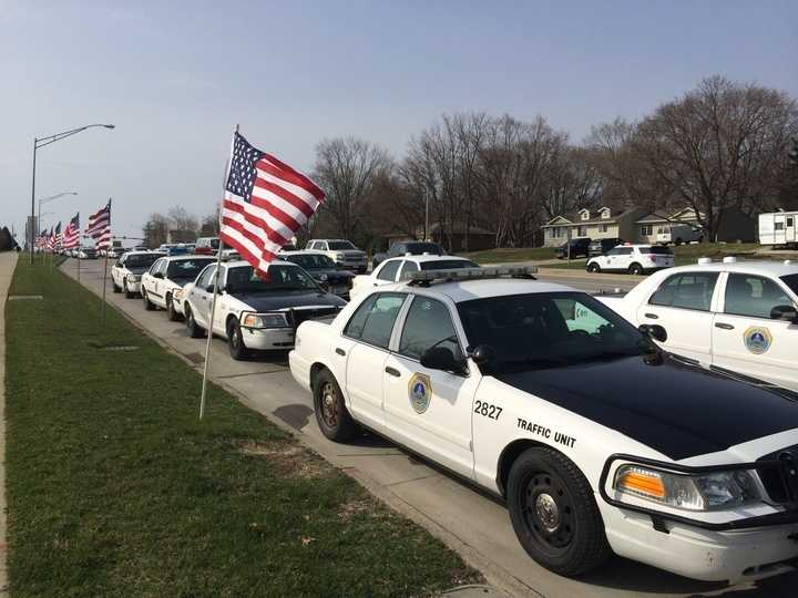 Police outside the funeral of Officer Farrell