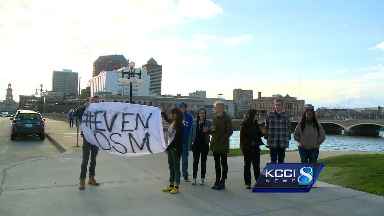 About two dozen people rallied Friday across the street from the Des Moines police station.