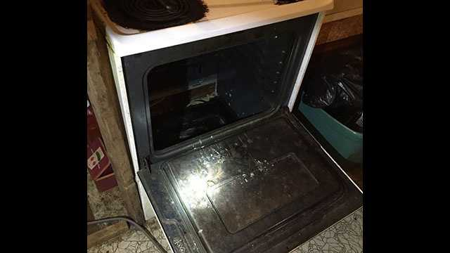 Authorities say a woman hide inside a stove during a search.