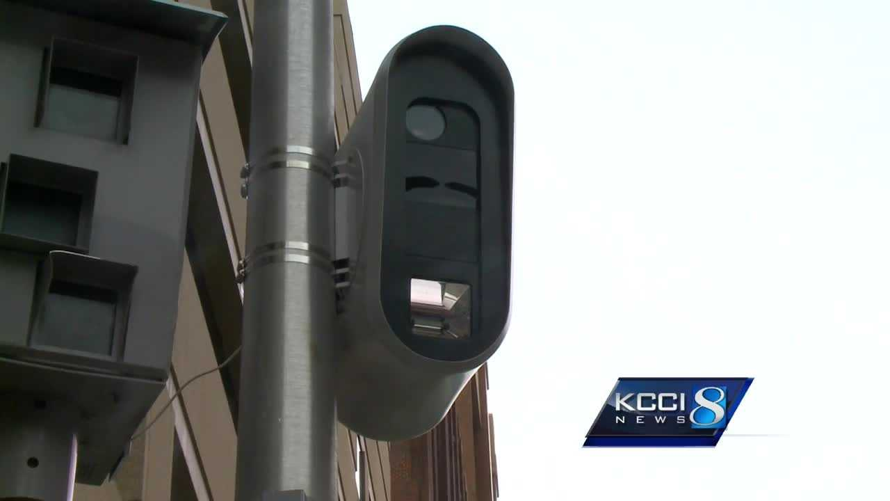 Downtown workers said making the red light camera here sensitive to speeding vehicles is a no-brainer.