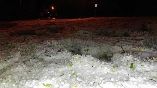 Drifts of hail pile up during AM storms.