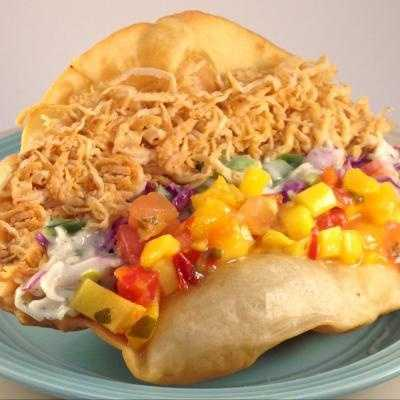 A deep fried flour tortilla crispy, flaky and golden.  Add a layer of tender hickory smoked bacon bits, cheddar jack cheese, fresh avocado relish, chipolte topped with a sweet mango salsa to add color and a spicy-sweet finish. Found at the Iowa Turkey Federation $5.00
