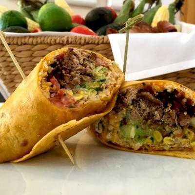 "A 12"" warmed jalapeno cheddar tortilla with pork shoulder, sweet corn salsa,hickory smoked bacon bits, cheddar jack cheese, fresh avocado relish, chipolte aioli and crispy tortilla bites for added texture to the wrap.  Found at G. Migs $8.00"