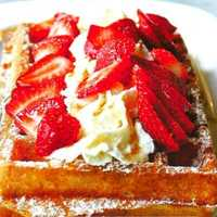 Light & fluffy, crispy crunchy Authentic Belgian Waffle, topped with strawberry glaze, fresh made Chantilly cream, fresh sliced strawberries and drizzled with white chocolate. Found at The Belgian Waffle Café $6.00