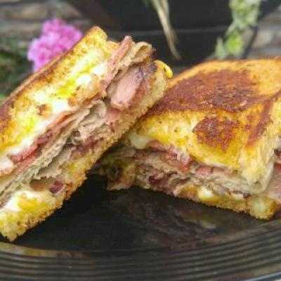 Artesian style cheddar bread smeared with a signature dry rub butter, then layered with provolone, farmer and cheddar cheese, shaved smoked beef brisket, apple wood smoked bacon and grilled until golden brown. Found at The Rib Shack $7.00