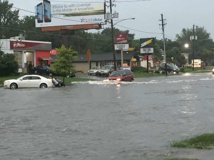 Flooding along Merle Hay Road just south of the mall.