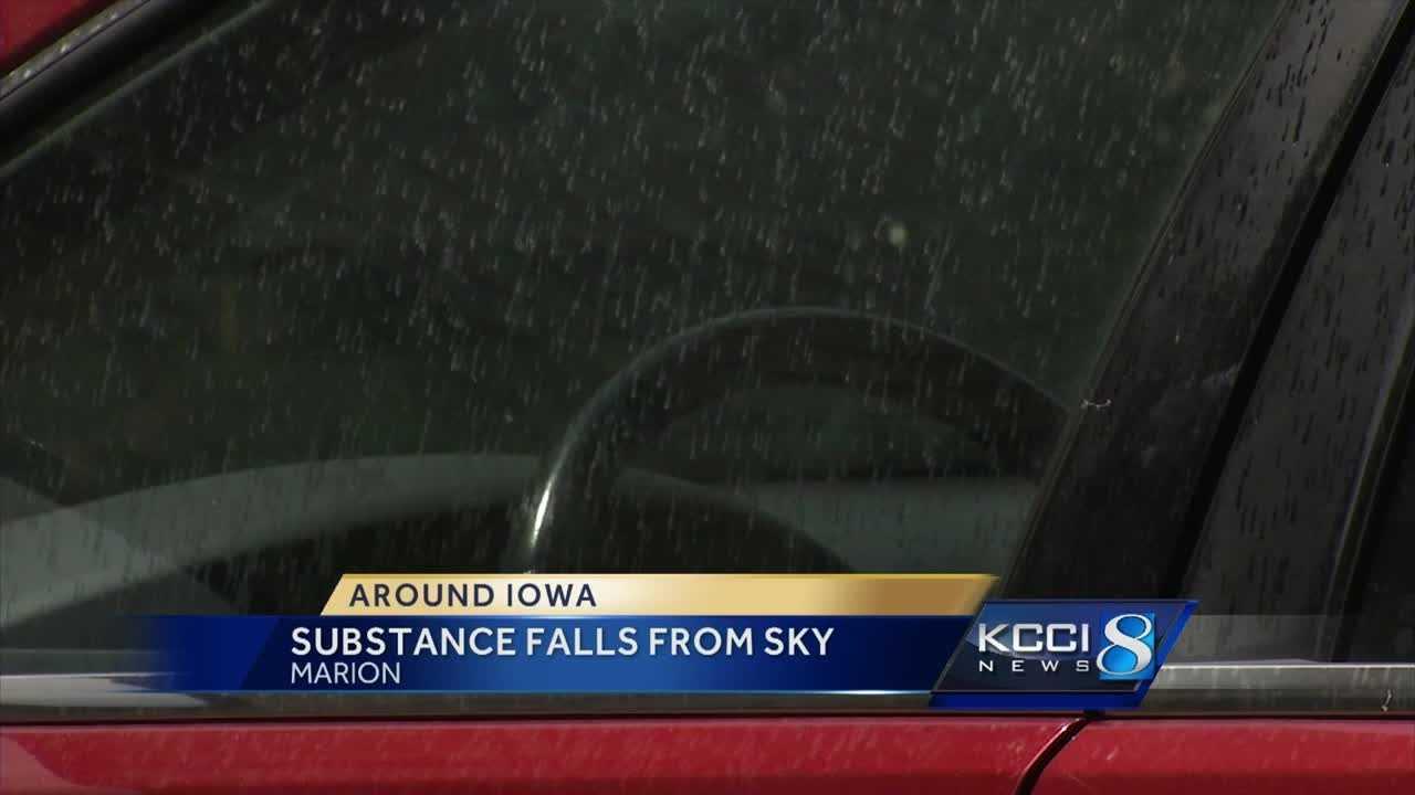 Authorities say an unidentified chemical has rained down on an Iowa neighborhood.