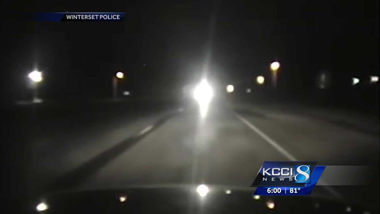 A Winterset police officer narrowly avoided a head-on collision with an intoxicated driver, and the incident was caught on camera.