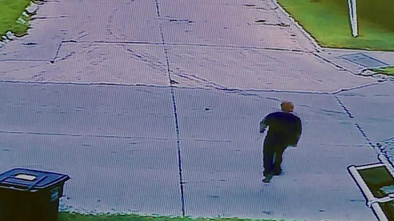 Security camera footage shows a man stealing a package from a Des Moines family's front porch.