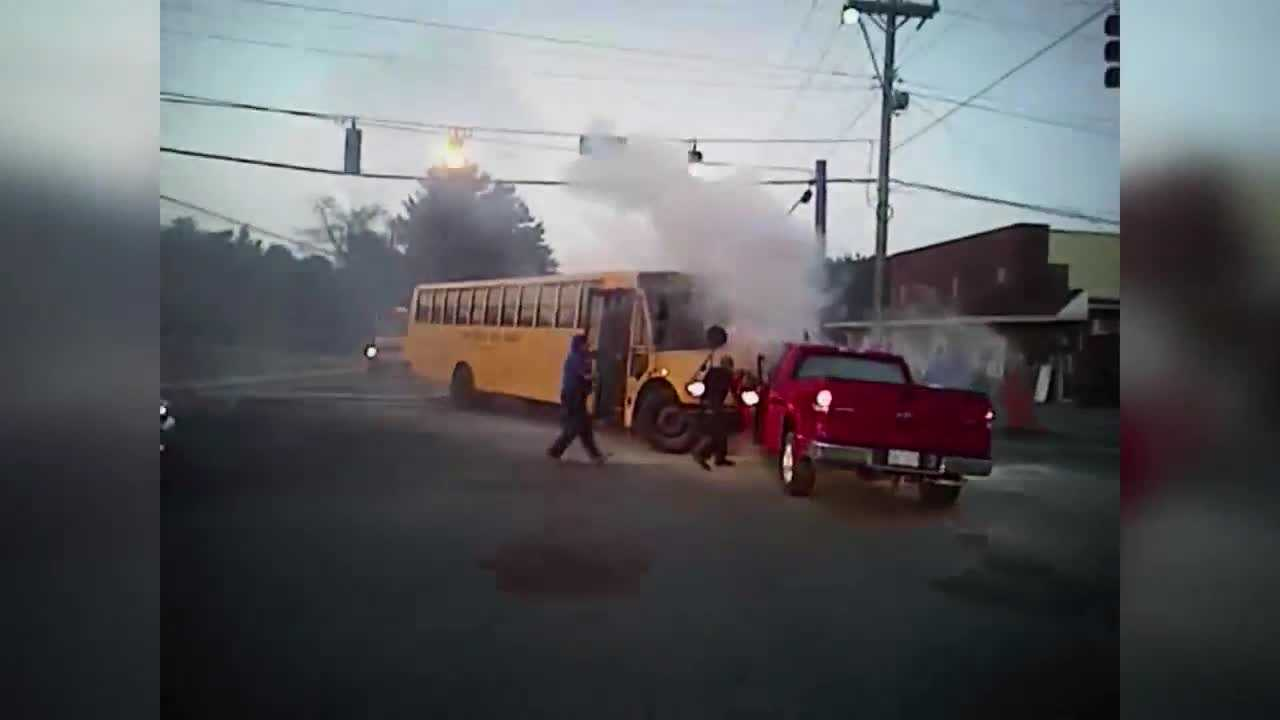 A driver trapped inside a burning truck under a bus was rescued by bystanders and fire crews in Winston-Salem, N.C.