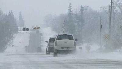 Snow Blowing Across Road