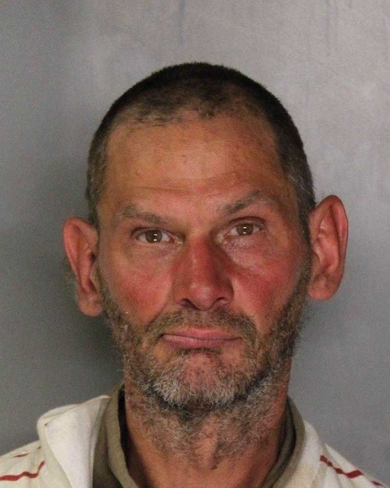 Russel Poppenga, 50, was arrested after yelling at an officer and pushing a police horse, Sacramento police said.