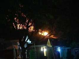 10:15 p.m. -- Flames are seen coming from apartment&#x3B; how the fire began remains unknown. 11:20 p.m. -- KCRA 3 learns that the fire was likely a result of devices deployed from authorities.
