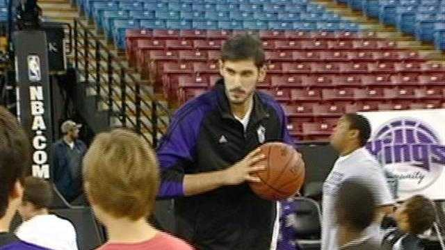 Kings player Omri Casspi shoots hoops with local kids as a part of the Kings in the Community program.