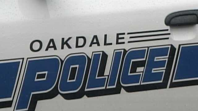 mon jan 25 oakdale police door of police car generic - 22337695