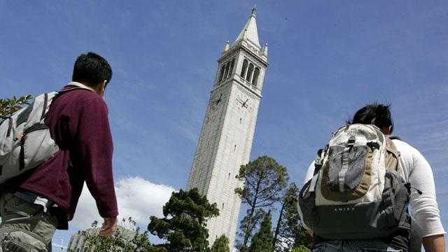 Students walk by Sather Tower on the UC Berkeley campus.