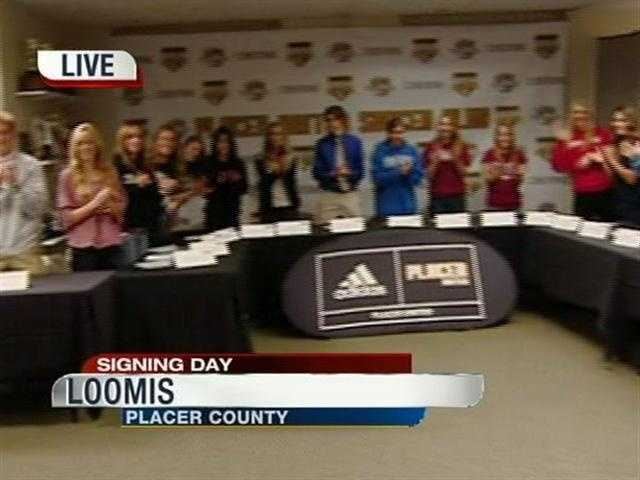 Student-athletes who signed letters of intent at the Placer United Soccer Club thanked their parents and friends with a standing ovation.