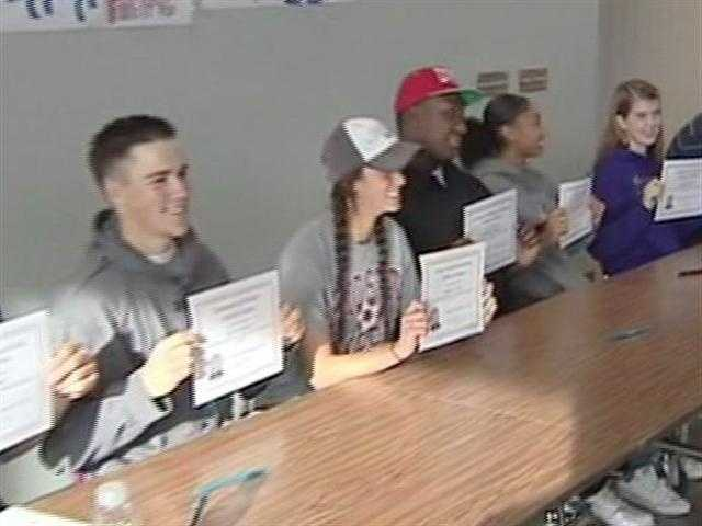 Students at Lincoln High School in Stockton show off their signed letters of intent.