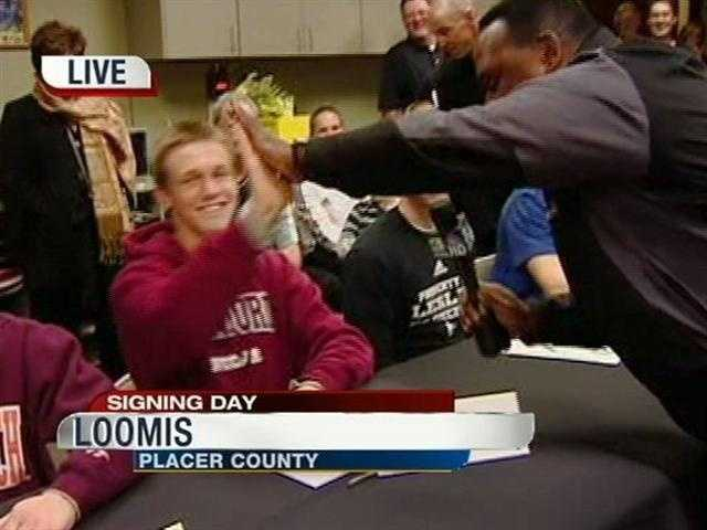 Ty Thompson gets a high-five from Del Rodgers&#x3B; Thompson has committed to play soccer at Stanford next year.