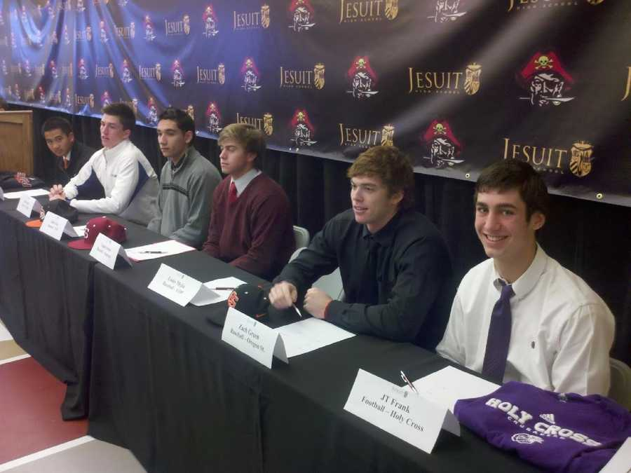 Students at Jesuit High School sign their letters of intent.