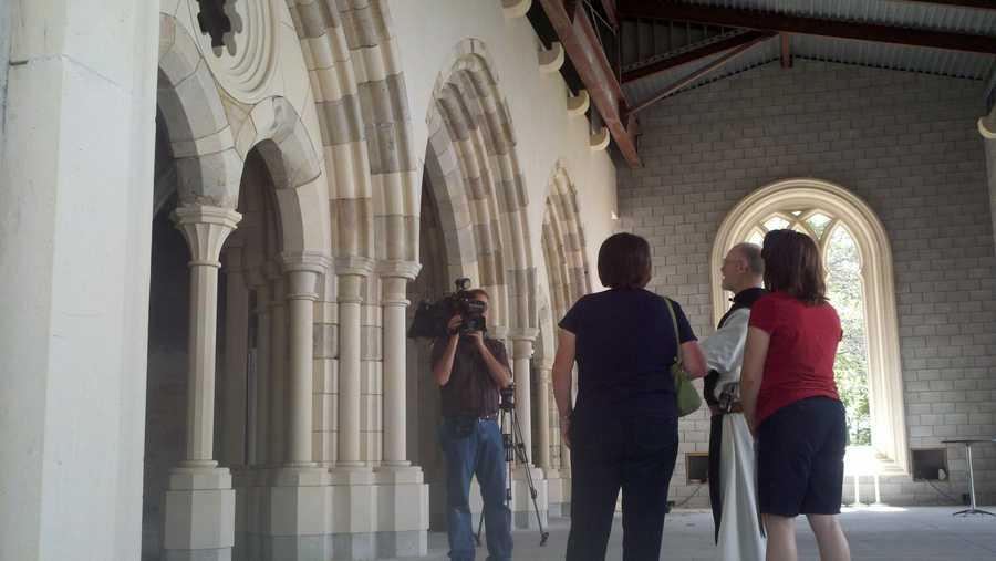 Visitors admire the portals of the building.