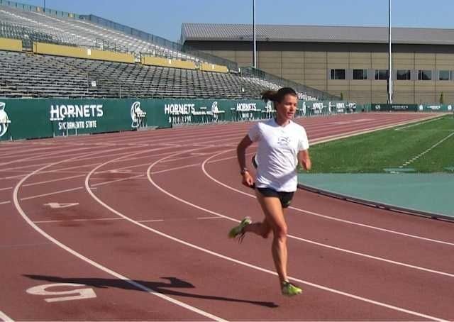 Kim runs the 5000m, which is roughly three miles.