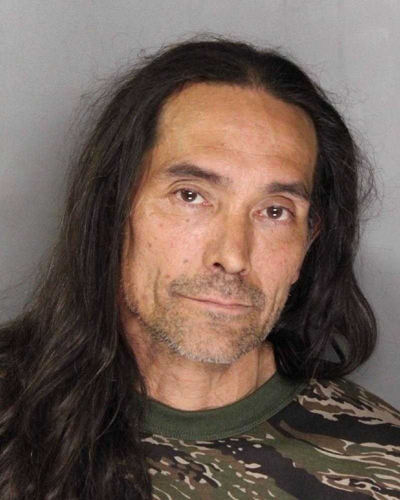Kelly Miller was arrested after police said he violated terms of a previous felony conviction by firing a weapon in his backyard.