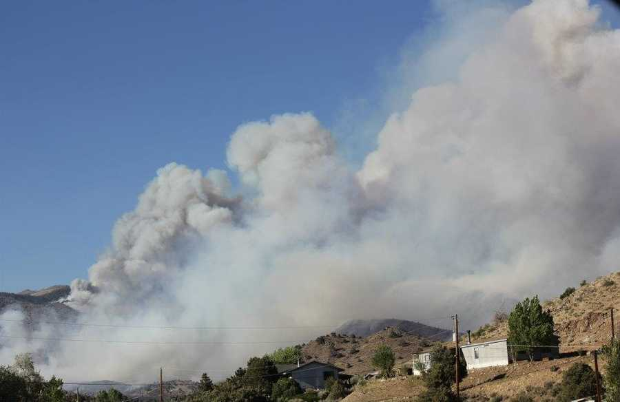 Smoke and flame burn dangerously close to homes in an area known as Topaz Ranch Estates.