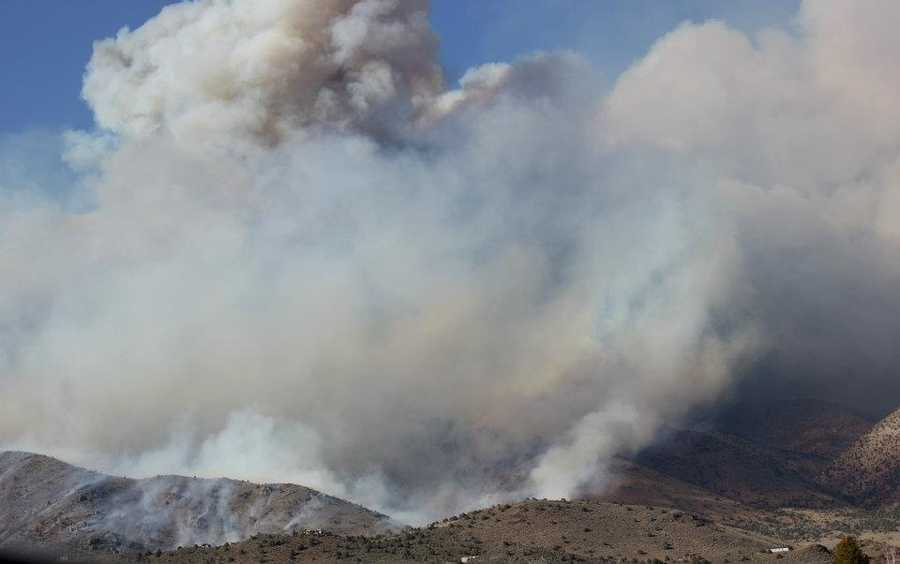 Sagebrush and pinion pine fuel a wildfire in Nevada.