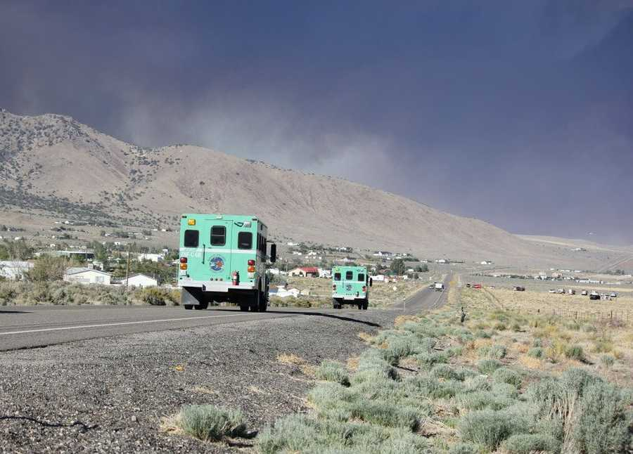 Nevada Division of Forestry crew trucks race to the sight of a 4,400 acre wildfire.