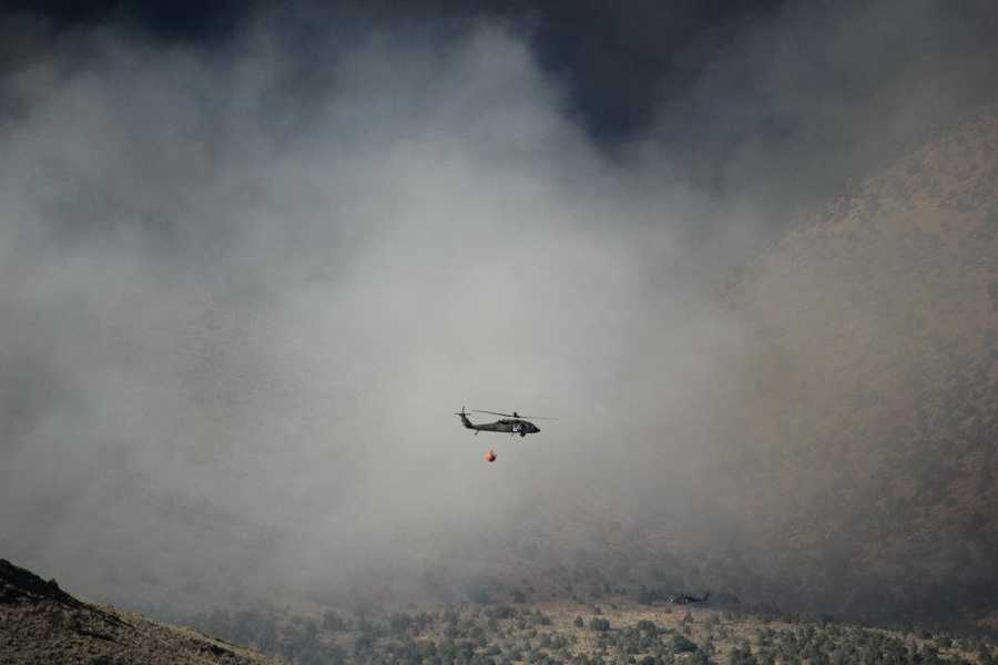 Pilots have to navigate steep terrain often times in blinding smoke.