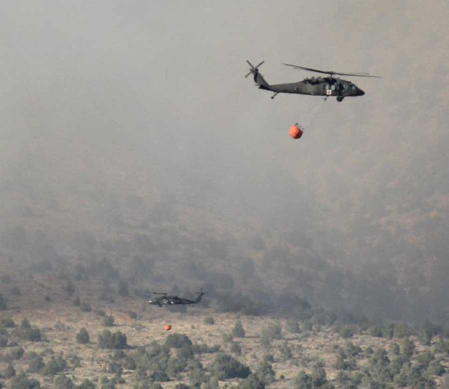 The buckets beneath the blackhawk helicopters can carry 660 gallons of water.