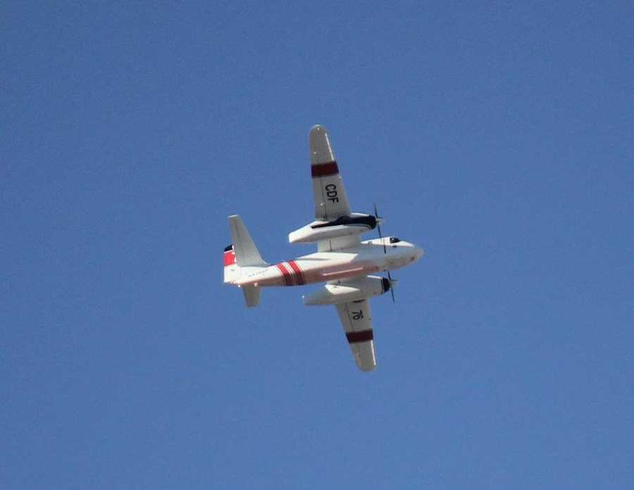 A firefighting plane from Cal Fire assists with the fight in Nevada.