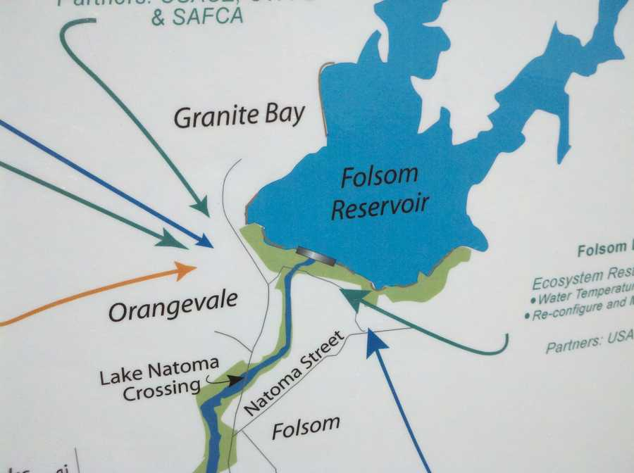 A map is displayed during a ceremony at Folsom Lake Thursday.